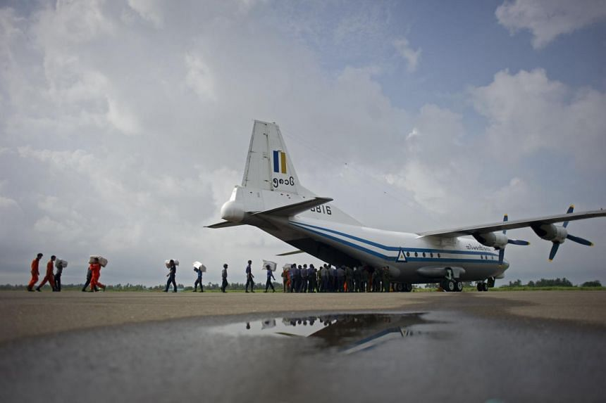 A Myanmar Air Force Shaanxi Y-8 transport aircraft being unloaded at Sittwe airport in Rakhine state, similar to the aircraft carrying over 100 people that went missing between the southern city of Myeik and Yangon on June 7, 2017.