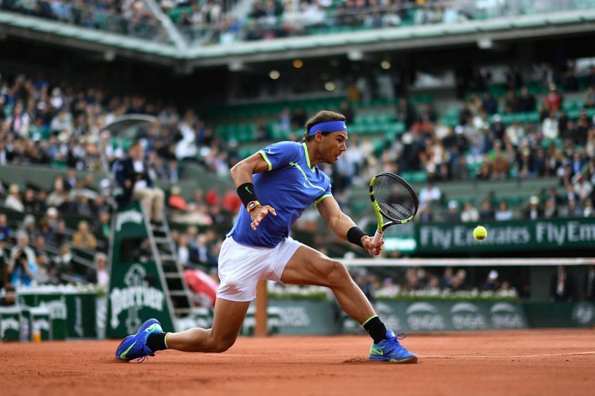 Spain's Rafael Nadal returns the ball to Spain's Pablo Carreno Busta during their tennis match at the Roland Garros 2017 French Open in Paris on June 7, 2017.