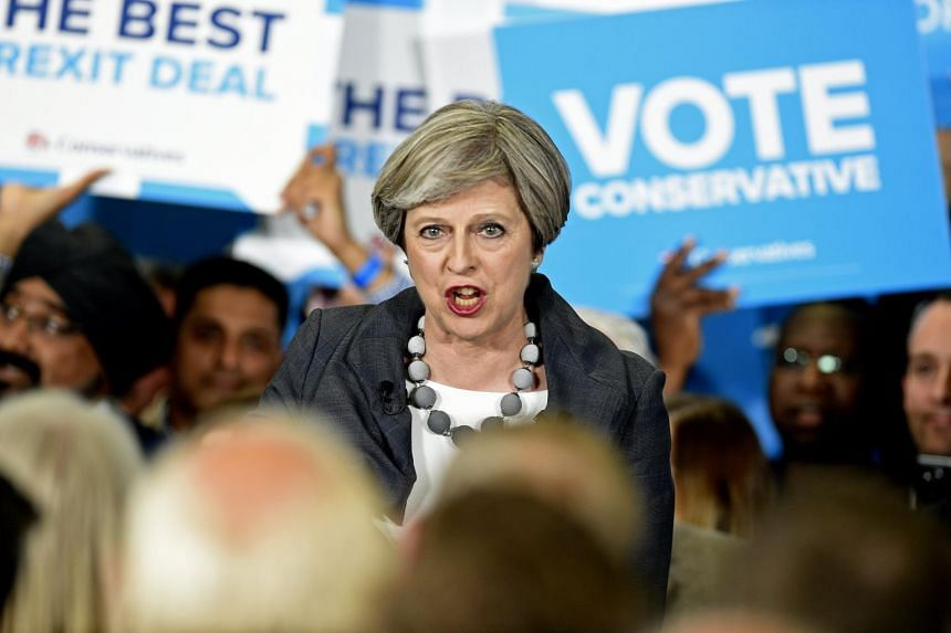 British Prime Minister Theresa May delivers a speech at the Segro office block on Slough Industrial Park.