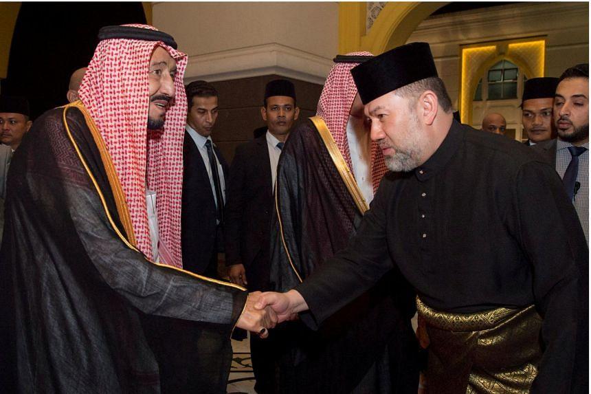 Saudi Arabia's King Salman shaking hands with Malaysian King Muhammad V in Kuala Lumpur, Malaysia, on Feb 26, 2017.