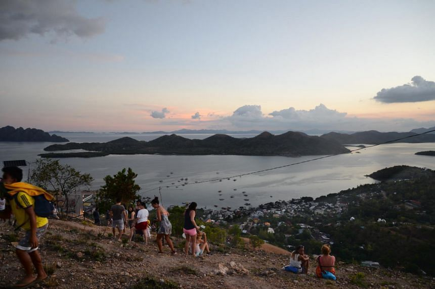 Tourists in the town of Coron in Busuanga Island, Palawan, Philippines.