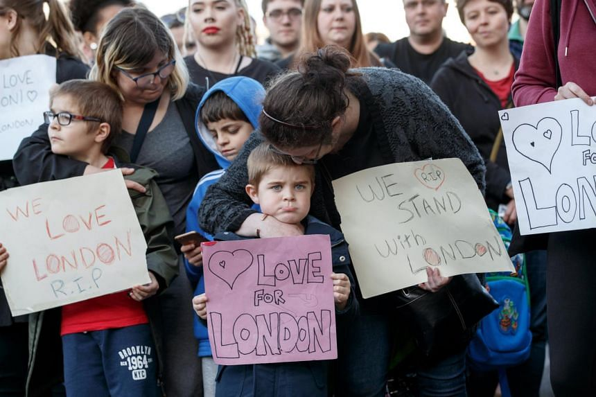 Supporters holding signs of condolence for the victims of the London attacks in Carlisle, Britain, on June 4, 2017.