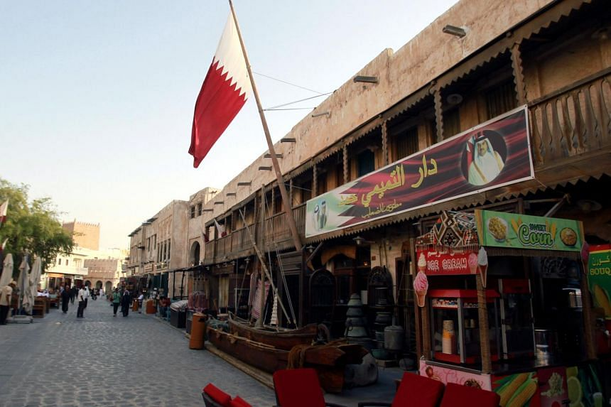 A shop with a picture of Qatar's Emir Sheikh Tamim Bin Hamad Al-Thani is seen in Doha.