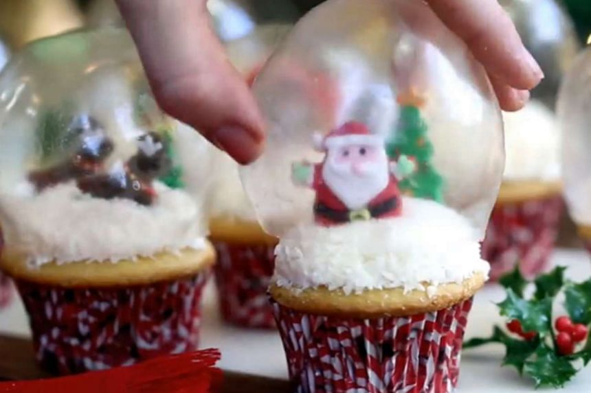 (Above) A screengrab of the tutorial video Ms Elizabeth LaBau posted last Christmas for her snow-globe cupcake recipe, which she first shared on her website SugarHero.com in late 2014. She claims the Food Network's how-to video on snow-globe cupcak