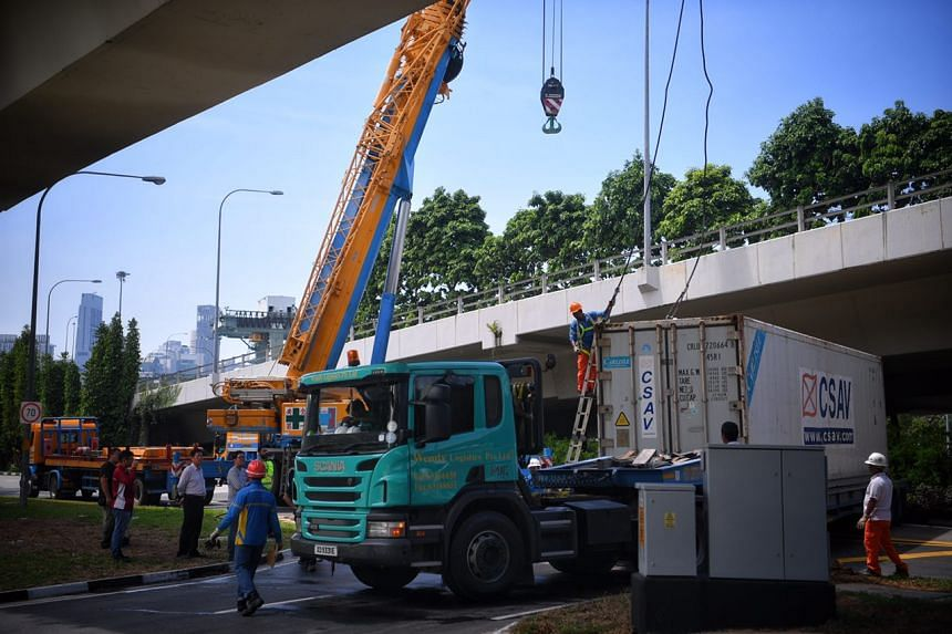 Two cranes were deployed to removed the trailer from Keppel Road after it overturned.