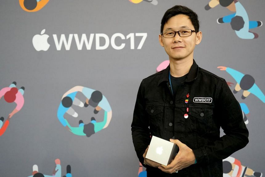 Mr Muh Hong Cheng of Clean Shaven Apps collecting the Apple Design Awards trophy at Apple's annual worldwide developer conference. His company is one of the 10 winners this year for their currency converter app, Elk.