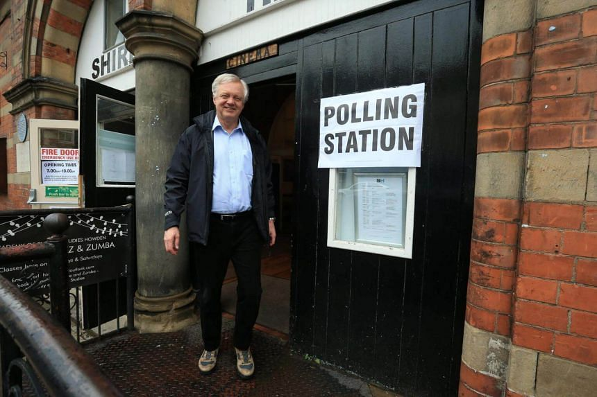 Conservative candidate for Haltemprice and Howden David Davis leaving a polling station in Howden, northeast England on June 8, 2017.