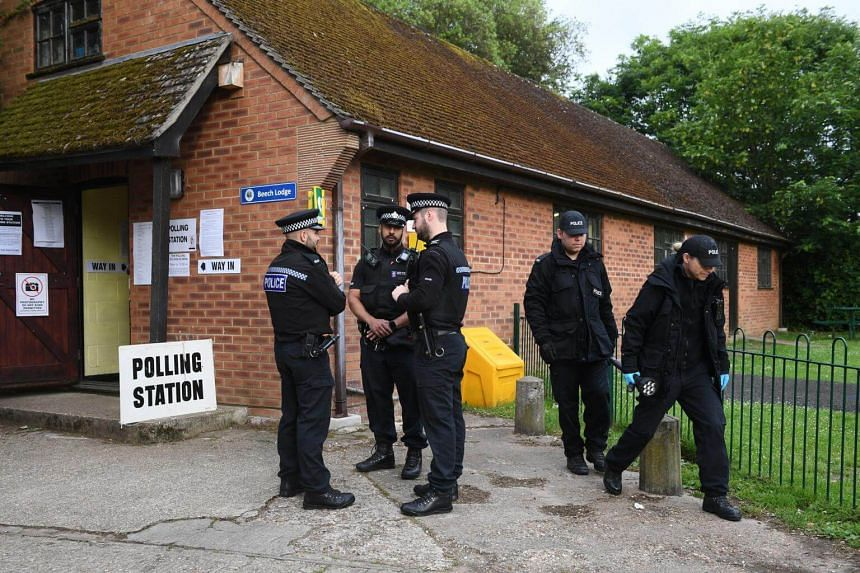 Police outside a polling station where Britain's Prime Minister, Theresa May and her husband Philip May are expected to vote in the General election, in Sonning, near Reading, Britain, on June 8, 2017.