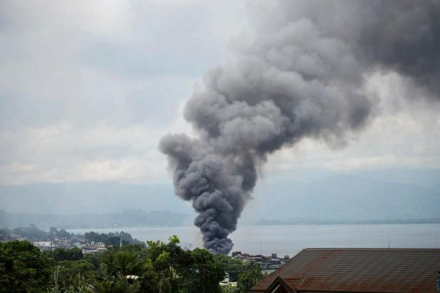 Smoke rises after aerial bombings by Philippine Air Force planes on Islamist militant positions in Marawi, on the southern island of Mindanao on June 6, 2017.