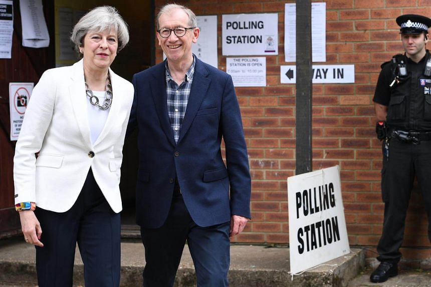 Britain's Prime Minister, Theresa May and her husband Philip May arriving to vote in the British General election in Sonning, near Reading, Britain, on June 8, 2017.