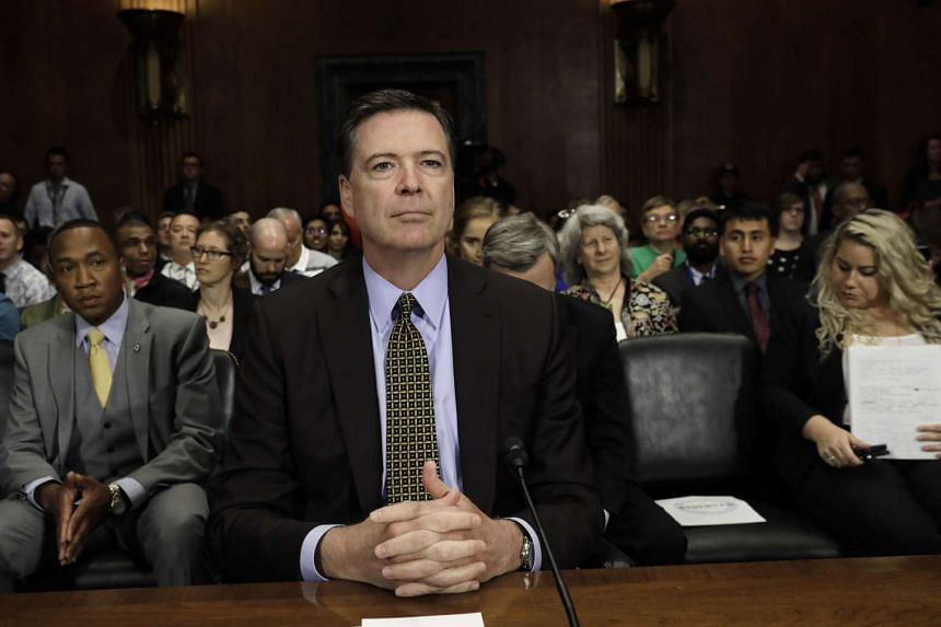 Comey prepares to testify before a Senate Judiciary Committee hearing in May 2017.