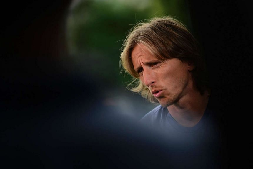 Real Madrid's Croatian midfielder Luka Modric attends an interview in the mixed zone at Valdebebas Sport City in Madrid on May 30, 2017.