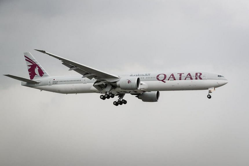 A Qatar Airways plane preparing to land at the Manila International Airport in Pasay City, south of Manila, in the Philippines, on June 7, 2017.
