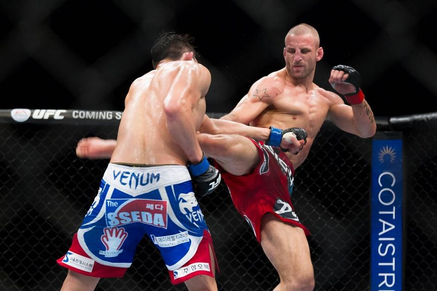 Saffiedine battering his opponent incessantly with a barrage of kicks and punches during the Ultimate Fighting Championship event held at the Marina Bay Sands in 2014.