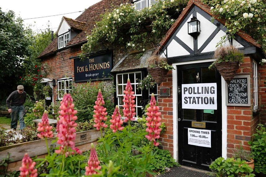 A man arriving at a pub, set up as a Polling Station, in Christmas Common, near Oxford, west of London, on June 8, 2017.
