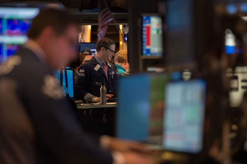 A trader working on the floor at the closing bell of the Dow Jones at the New York Stock Exchange on April 6, 2017 in New York.