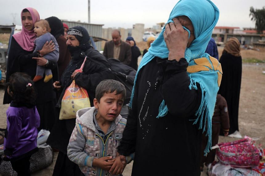 An Iraqi woman in April mourning members of her family, including her husband, who were killed by ISIS militants as they tried to flee western Mosul.