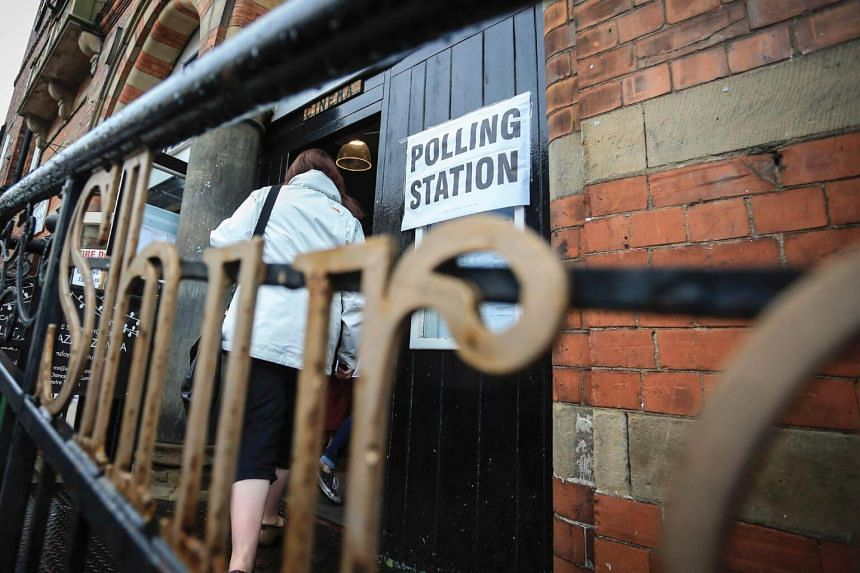 A woman arriving at a polling station in Howden, northeast England on June 8, 2017.