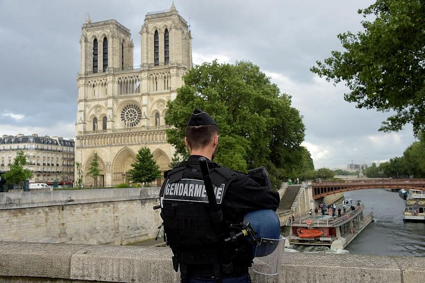 A gendarmeguards the attack site, Notre-Dame Cathedral, on Tuesday.