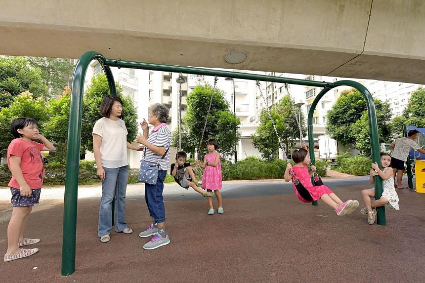 Punggol has more than 70 playgrounds spread across its various HDB developments, as well as the 4.2km Punggol Waterway. Punggol MP Sun Xueling (second from left in the picture on the right) talking to a resident in a children's playground. There are