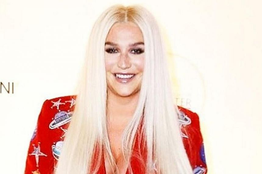 Pop star Kesha at the National Night of Laughter and Song event in Washington, DC on Monday night. Comedian Jerry Seinfeld, who did not know who she was, rejected her attempt to hug him.