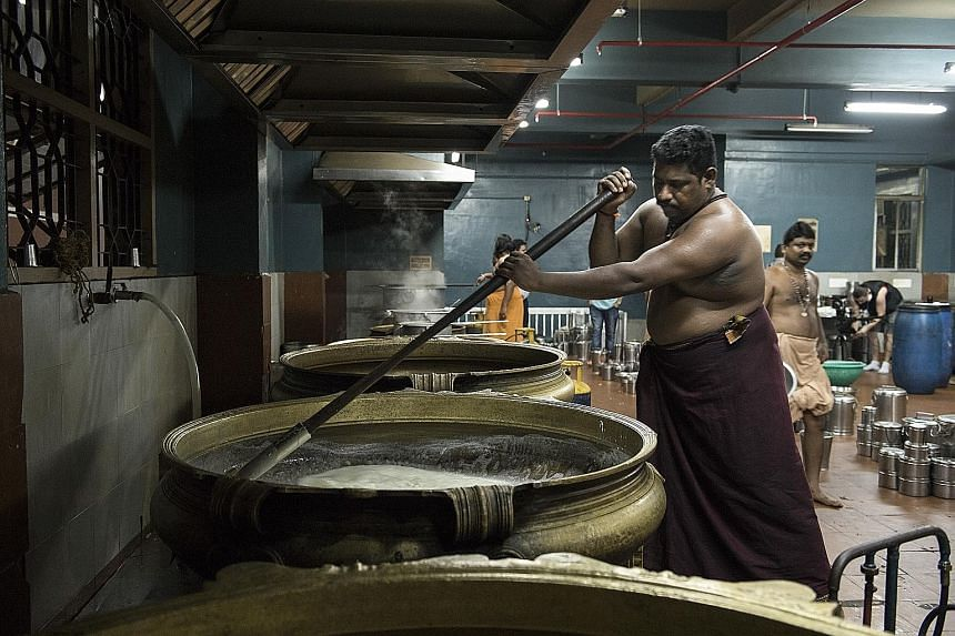 Cooks prepare the Hindu celebratory meal called a sadhya in pots as big as wading pools in Kochi, Kerala (above). Asha Gomez (below), in a tea plantation in Munnar, Kerala, wants to put the spotlight on the tradition and history of Indian food.