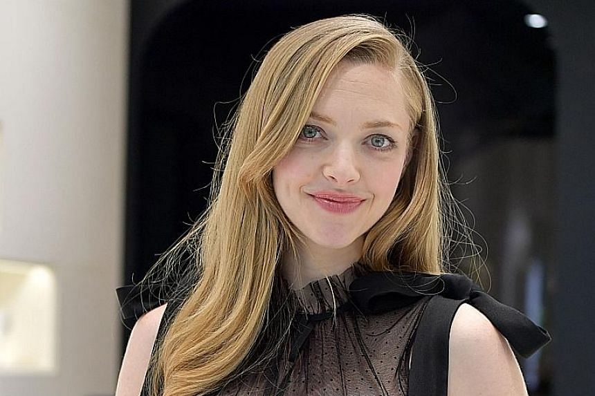American actress and brand ambassador Amanda Seyfried (right) attended the official opening of Cle de Peau Beaute's Mandarin Gallery store (above).