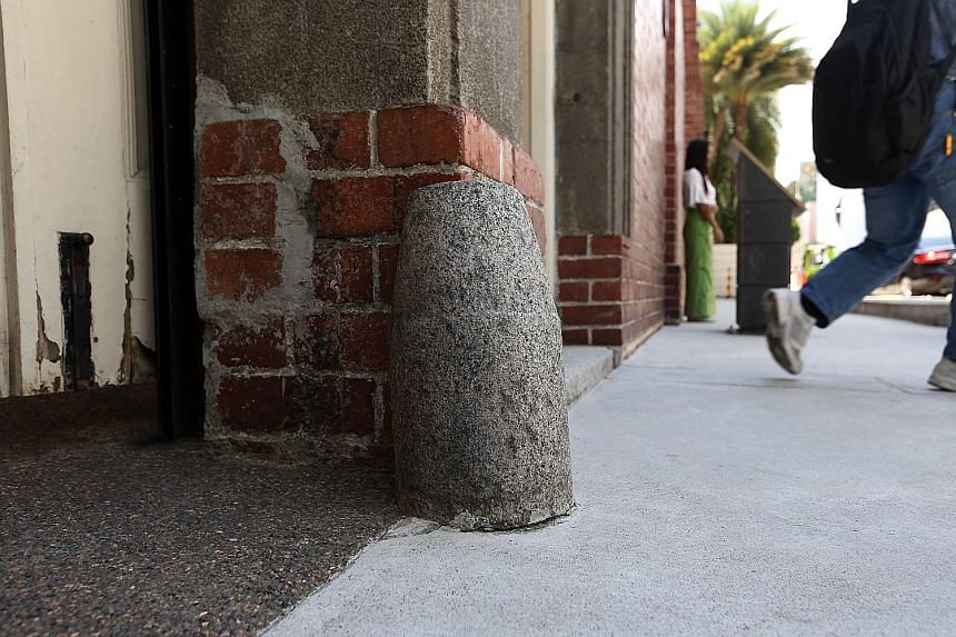The function of the original stones at the doors of the Prinsep Street Presbyterian Church was to prevent horse carriages from damaging the doors.