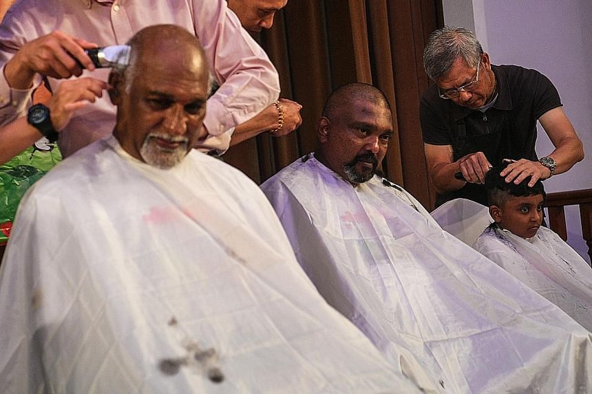 """""""A family that shaves together, stays together,"""" said ComfortDelGro cabby Kanapathy Shunmugam (far left), 65, seen here with his brother Ponnappon Sathiyaverthan, 46, and nephew Matsyendra, seven. Mr Shunmugam's wife, daughter, son-in-law and grands"""