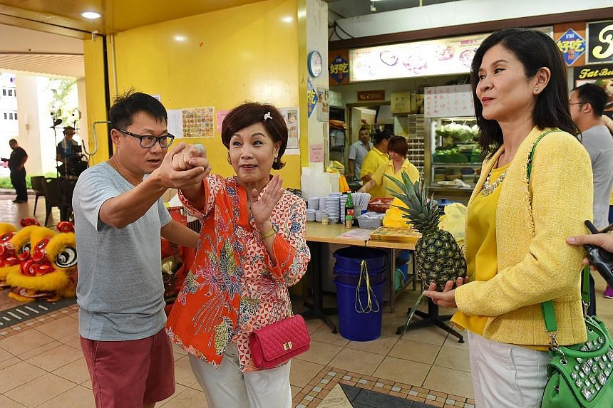 Director Kelvin Tong guiding Hsu Chiung Fang through a rehearsal as actress Lin Mei Jiao looks on. The TV series Eat Already? is in production for its third season and will air on Channel 8 from Aug 18.