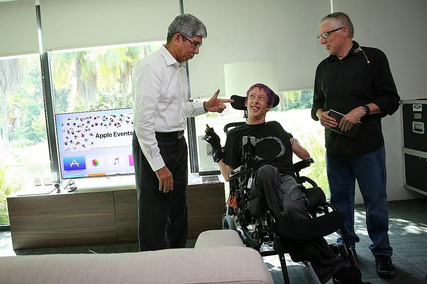 Dr Yaacob Ibrahim with Mr Christopher Hills and his father Garry, who held a workshop on tech tools to help people with disabilities.
