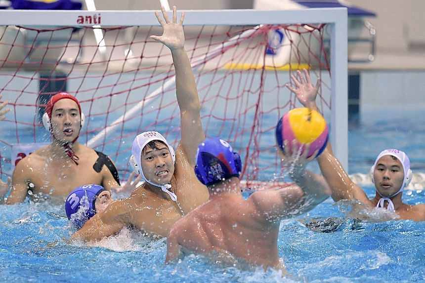 Chow Jing Lun (centre) attempting to block a shot as the Singapore national team sparred with the Serbian youth team in training. The other sides in the Singapore Water Polo Challenge Cup are Iran and UNSW West Magpies.