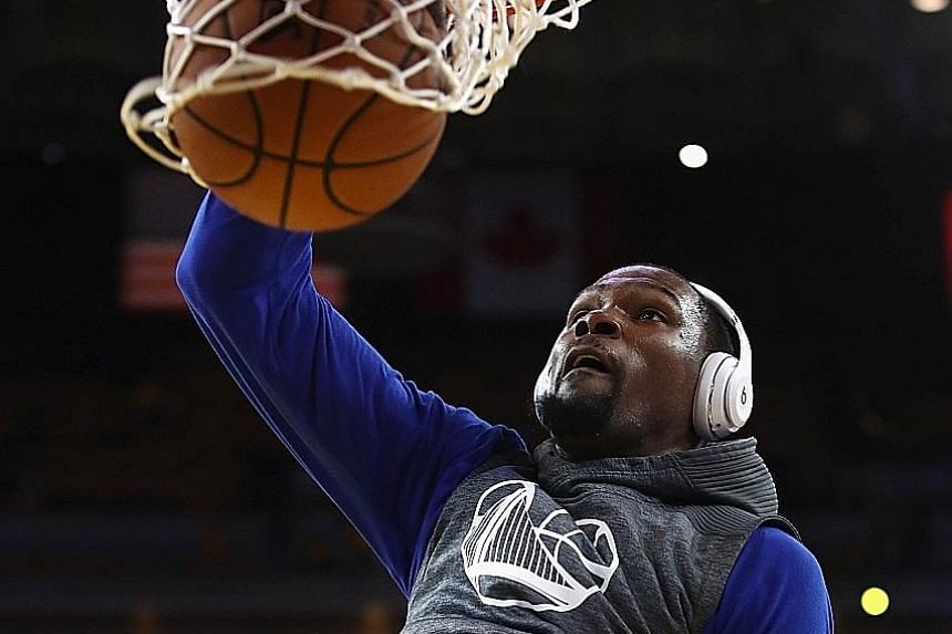 Warriors star Kevin Durant dunks the ball during training. The forward led all scorers in both Game One and Game Two of the NBA Finals with 38 points and 33 points respectively.