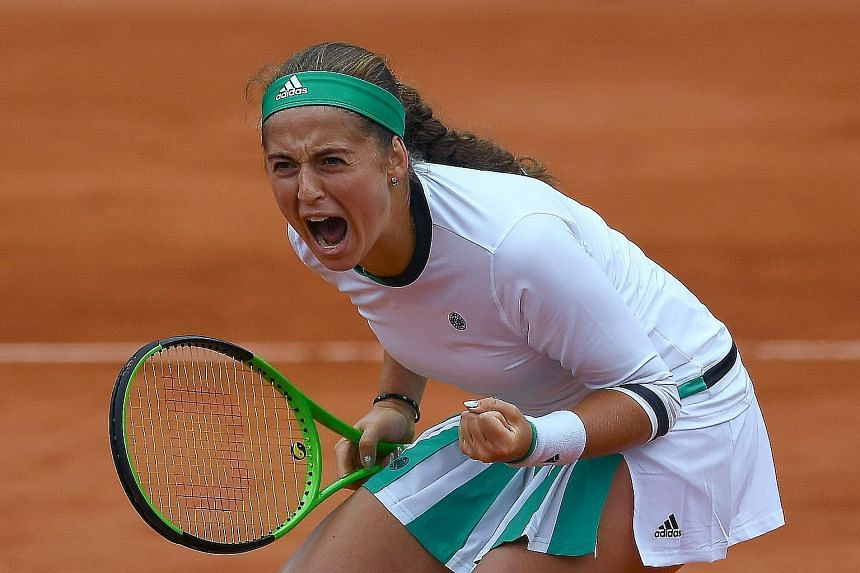 Latvian Jelena Ostapenko reacting after winning a point against Dane Caroline Wozniacki in the French Open quarter-finals.