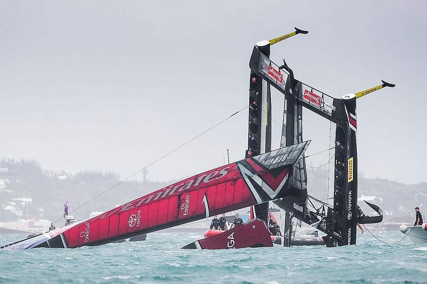 Team New Zealand's boat capsizes at the start of the America's Cup Challenger Play-offs semi-finals. Competing against Britain's Land Rover BAR in Bermuda, the Kiwis were heading to the start line when strong winds forced the boat to plunge into the