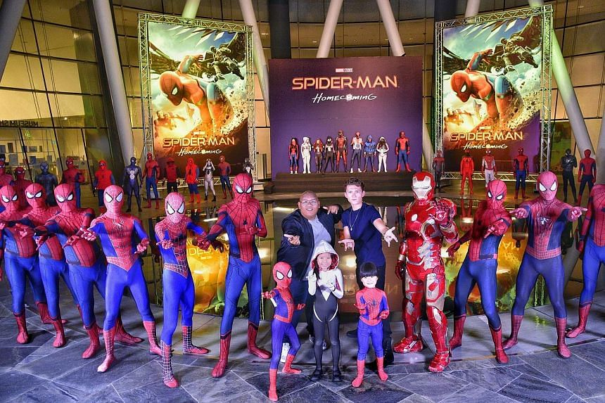 The stars of upcoming movie Spider-Man: Homecoming Jacob Batalon (centre left) and Tom Holland posing with costumed Spider-Man fans after the closed-door, red-carpet event for the movie. The actors are in town for a few days to promote the latest fil