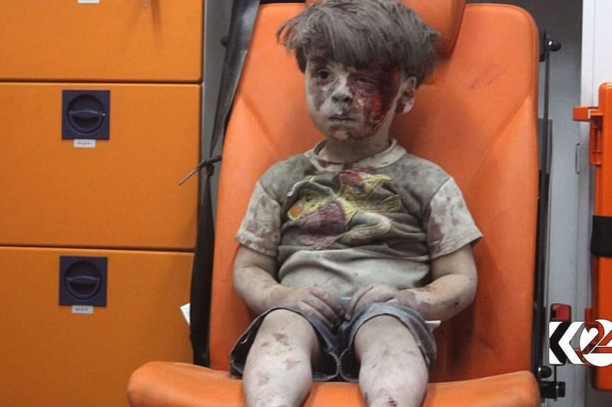 Omran Daqneesh, whose shell-shocked image last year came to symbolise the plight of civilians besieged by government forces in Aleppo, has re-appeared in interviews on pro-Assad news channels, apparently part of a calculated public relations campaign