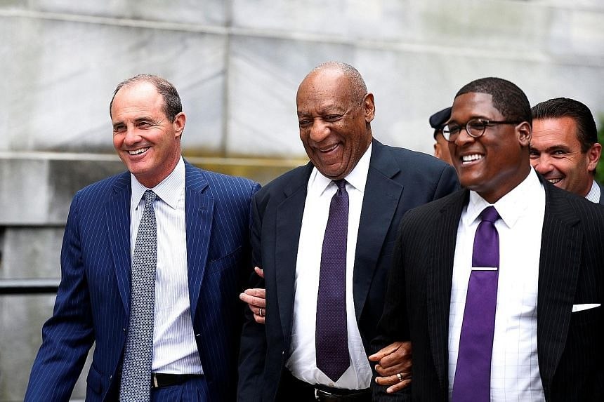 Bill Cosby leaving court with his team after the second day of his trial in Pennsylvania on Tuesday. The Emmy-winning TV star faces three counts of aggravated indecent assault against his accuser. But he says their sexual relations were consensual.