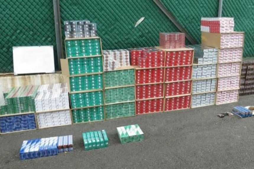 A total of 2,776 cartons, 345 packets and 43 sticks of duty-unpaid cigarettes were seized by Singapore Custom officers from the van and the unit.