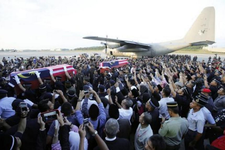 The bodies of Malaysian policemen arriving at Subang airport on March 4, 2013. They were killed during fighting in February 2013 in Sabah against members of an armed faction from the Philippines.