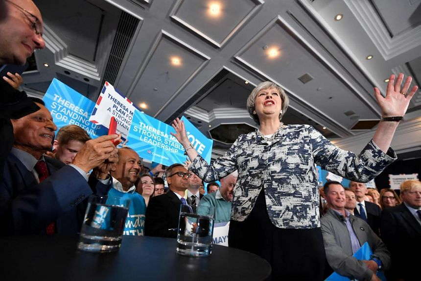 Britain's Prime Minister and leader of the Conservative Party Theresa May speaks during a general election campaign rally in Birmingham.