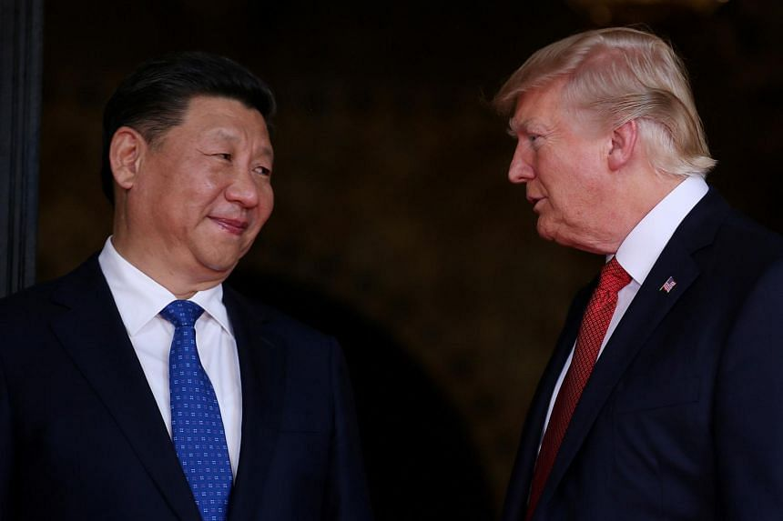 US President Donald Trump welcomes Chinese President Xi Jinping at Mar-a-Lago state in Palm Beach, Florida on April 6, 2017.