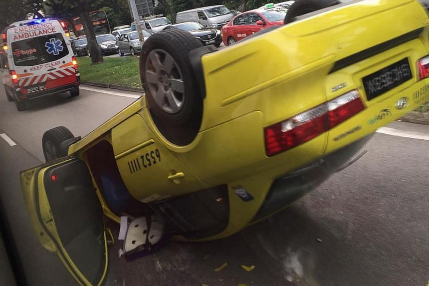 Taxi flipped over after an accident involving two other cars at Tampines on June 6, 2017.