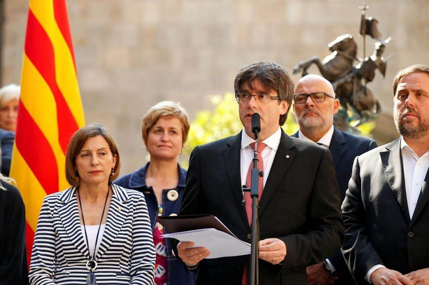 Catalonia's regional President Carles Puigdemont announces a referendum on a split from Spain outside the Palau de la Generalitat, the regional government headquarters, in Barcelona, Spain, on June 9, 2017.