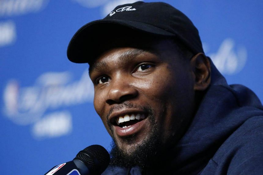 Golden State Warriors player Kevin Durant talks to media during media availability on the day before game four of the NBA Finals basketball game at Quicken Loans Arena in Cleveland, Ohio, USA, on June 8, 2017.