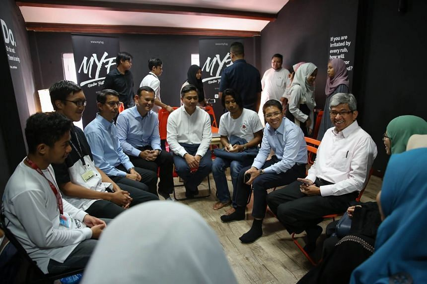 Dr Yaacob Ibrahim (right) speaking to youths from the Muslim Youth Forum (MYF).