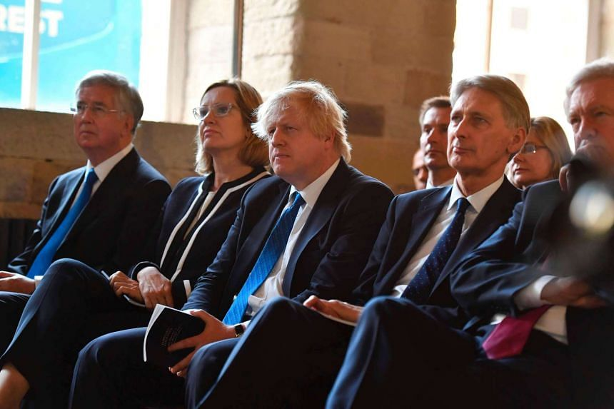 (Left to right) Mr Michael Fallon, Ms Amber Rudd, Mr Boris Johnson, Mr Philip Hammond and Mr David Davis listen as Britain's Prime Minister Theresa May speaks during the Conservative Party general election manifesto in Halifax on May 18, 2017.