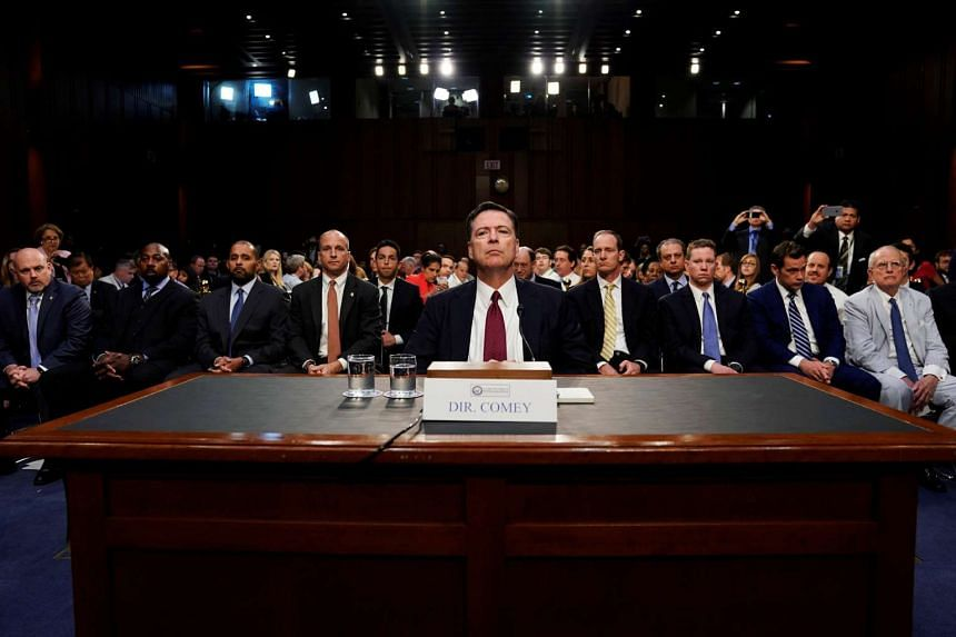 Former FBI Director Comey testifies before a Senate Intelligence Committee hearing in Washington.