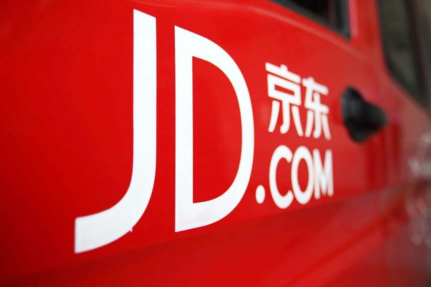 A JD.com Inc. logo is seen on a door of delivery van at a company warehouse in Shanghai, China, on April 27, 2015.