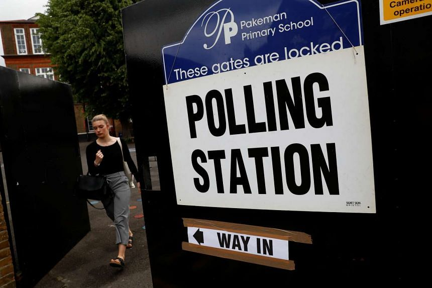 A voter arrives at a polling station in London, Britain June 8, 2017.